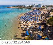 Купить «Protaras, Cyprus - Oct 11. 2019 The Famous fig tree beach of city», фото № 32284560, снято 11 октября 2019 г. (c) Володина Ольга / Фотобанк Лори
