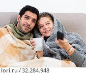 Купить «Couple together under blanket watching TV», фото № 32284948, снято 22 февраля 2020 г. (c) Яков Филимонов / Фотобанк Лори