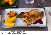 Iberian pork in sweet wine and vegetable sauce. Стоковое фото, фотограф Яков Филимонов / Фотобанк Лори
