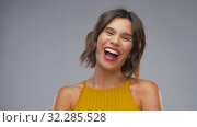 Купить «happy laughing young woman in mustard yellow top», видеоролик № 32285528, снято 7 октября 2019 г. (c) Syda Productions / Фотобанк Лори