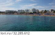 Protaras, Cyprus - Oct 11. 2019. The Famous Sunrise Beach -a beautiful public Beach. Редакционное видео, видеограф Володина Ольга / Фотобанк Лори