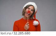 Купить «woman in santa helper hat having fun on christmas», видеоролик № 32285680, снято 7 октября 2019 г. (c) Syda Productions / Фотобанк Лори