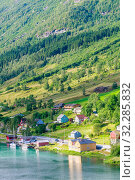 Купить «Small  houses at Olden, Norway.Olden is a village and urban area in the municipality of Stryn in Sogn og Fjordane county, Norway.», фото № 32285832, снято 10 июля 2020 г. (c) Николай Коржов / Фотобанк Лори