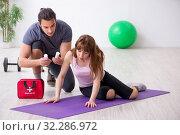 Купить «Young woman feeling bad during training in first aid concept», фото № 32286972, снято 10 мая 2019 г. (c) Elnur / Фотобанк Лори