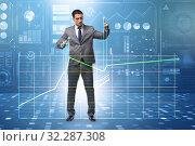 Купить «Businessman controlling the market with strings», фото № 32287308, снято 5 декабря 2019 г. (c) Elnur / Фотобанк Лори