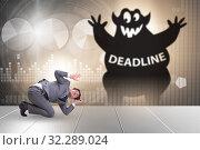 Купить «Businessman missing important deadline with monster», фото № 32289024, снято 20 октября 2019 г. (c) Elnur / Фотобанк Лори