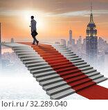 Купить «Young businessman climbing stairs and red carpet», фото № 32289040, снято 21 октября 2019 г. (c) Elnur / Фотобанк Лори