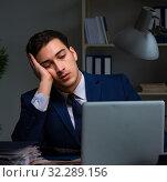 Купить «Businessman tired and sleeping in the office after overtime hour», фото № 32289156, снято 21 декабря 2017 г. (c) Elnur / Фотобанк Лори