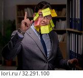 Купить «Businessman struggling with conflicting priorities during long h», фото № 32291100, снято 25 января 2017 г. (c) Elnur / Фотобанк Лори
