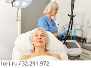 Senior woman waiting for cosmetic procedure in clinic of esthetic cosmetology. Стоковое фото, фотограф Яков Филимонов / Фотобанк Лори