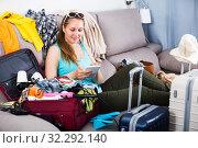 Купить «Woman getting ready for holidays», фото № 32292140, снято 21 марта 2017 г. (c) Яков Филимонов / Фотобанк Лори