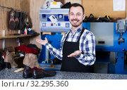 Ordinary man worker displaying his workplace. Стоковое фото, фотограф Яков Филимонов / Фотобанк Лори
