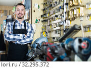 Adult worker showing his tools for making keys. Стоковое фото, фотограф Яков Филимонов / Фотобанк Лори