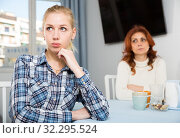 Portrait of sad mature woman trying to talk with daughter in home. Стоковое фото, фотограф Яков Филимонов / Фотобанк Лори