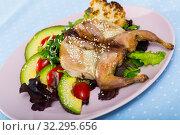 Купить «Plate with poultry dish - quail Tabaka», фото № 32295656, снято 26 января 2020 г. (c) Яков Филимонов / Фотобанк Лори