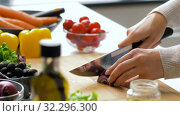 Купить «young woman chopping red onion at home», видеоролик № 32296300, снято 10 октября 2019 г. (c) Syda Productions / Фотобанк Лори
