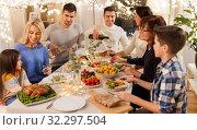 Купить «happy family having dinner party at home», фото № 32297504, снято 15 декабря 2018 г. (c) Syda Productions / Фотобанк Лори