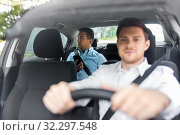 Купить «male passenger with smartphone and car driver», фото № 32297548, снято 25 августа 2019 г. (c) Syda Productions / Фотобанк Лори