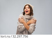 young woman in knitted winter hat and sweater. Стоковое фото, фотограф Syda Productions / Фотобанк Лори