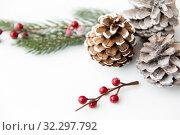 Купить «christmas balls and fir branches with pine cones», фото № 32297792, снято 26 сентября 2018 г. (c) Syda Productions / Фотобанк Лори