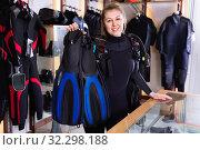 Купить «Sporty woman is satisfied of full set diving equipment in the diving store.», фото № 32298188, снято 25 января 2018 г. (c) Яков Филимонов / Фотобанк Лори