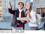 Купить «Man and woman with map and package looking attraction outdoors», фото № 32298204, снято 18 ноября 2017 г. (c) Яков Филимонов / Фотобанк Лори