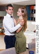 Купить «Loving couple in apartment», фото № 32298260, снято 24 сентября 2018 г. (c) Яков Филимонов / Фотобанк Лори