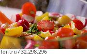 Купить «fresh vegetable salad seasoning with pine nuts», видеоролик № 32298296, снято 10 октября 2019 г. (c) Syda Productions / Фотобанк Лори