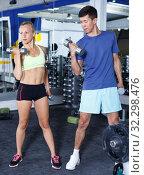 Купить «Couple during weightlifting workout», фото № 32298476, снято 16 июля 2018 г. (c) Яков Филимонов / Фотобанк Лори