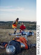 Купить «Old medieval knight in armor swings his sword», фото № 32304372, снято 5 июля 2019 г. (c) Tryapitsyn Sergiy / Фотобанк Лори