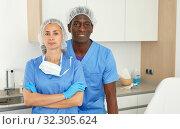 Cosmeticians woman and man in uniform in clinic of esthetic cosmetology. Стоковое фото, фотограф Яков Филимонов / Фотобанк Лори