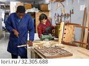 Купить «Artisans in process of renewing armchair», фото № 32305688, снято 2 февраля 2019 г. (c) Яков Филимонов / Фотобанк Лори