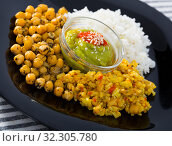 Dish of chickpeas and rice with red and green sauces. Стоковое фото, фотограф Яков Филимонов / Фотобанк Лори