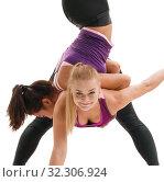 Купить «Slim sportswomen in tops and leggings in studio», фото № 32306924, снято 25 сентября 2016 г. (c) Гурьянов Андрей / Фотобанк Лори