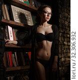 Купить «Nude woman posing in black lingerie, low key», фото № 32306932, снято 21 ноября 2016 г. (c) Гурьянов Андрей / Фотобанк Лори