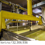 Купить «Technical equipment at diary plant close up view», фото № 32306936, снято 22 ноября 2016 г. (c) Гурьянов Андрей / Фотобанк Лори