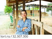 Купить «Happy woman near stable», фото № 32307300, снято 17 ноября 2019 г. (c) Яков Филимонов / Фотобанк Лори