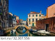 Купить «Venice with colorful buildings and canals, popular destination of Italy», фото № 32307556, снято 5 сентября 2019 г. (c) Яков Филимонов / Фотобанк Лори