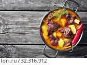 Купить «overhead view of Jamaican spicy Curry Goat», фото № 32316912, снято 1 июля 2019 г. (c) Oksana Zh / Фотобанк Лори