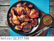 Купить «hot Grilled Jamaican Jerk Chicken, close up», фото № 32317160, снято 27 июля 2019 г. (c) Oksana Zh / Фотобанк Лори