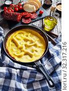 Купить «omelet in a skillet served with sliced chorizo», фото № 32317216, снято 2 августа 2019 г. (c) Oksana Zh / Фотобанк Лори