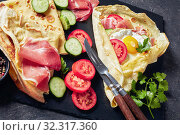 Купить «Crepe with fillings of egg, Jamon, salad», фото № 32317360, снято 17 августа 2019 г. (c) Oksana Zh / Фотобанк Лори