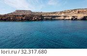 Купить «View from the sea to Cavo Greco in Protaras, Cyprus», видеоролик № 32317680, снято 21 октября 2019 г. (c) Володина Ольга / Фотобанк Лори