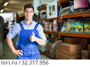 Portrait of male in uniform on his work position in building store. Стоковое фото, фотограф Яков Филимонов / Фотобанк Лори