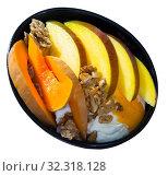 Mango and baked pumpkin with flakes and yogurt. Стоковое фото, фотограф Яков Филимонов / Фотобанк Лори