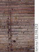 Купить «Texture of old metal shutters», фото № 32318212, снято 20 ноября 2019 г. (c) Яков Филимонов / Фотобанк Лори