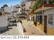 Typical street in the white village of Almachar, Axarquia mountains. Malaga province. Southern Andalusia, Spain. Europe. Стоковое фото, фотограф Jerónimo Alba / age Fotostock / Фотобанк Лори