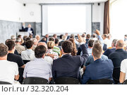Купить «I have a question. Group of business people sitting in conference hall. Businessman raising his arm. Conference and Presentation. Business and Entrepreneurship», фото № 32320204, снято 30 сентября 2019 г. (c) Matej Kastelic / Фотобанк Лори