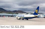 Купить «Aircraft by Ryanair drives on aerodrome to runway for takeoff. Ryanair is an Irish budget airline by scheduled passengers flown. Sofia Reian, Canary, Tenerife», фото № 32322256, снято 10 января 2016 г. (c) Кекяляйнен Андрей / Фотобанк Лори