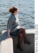 Купить «Woman dressed gray coat, jeans skirt and pantihose sitting on granite bank of river, looking at camera», фото № 32322272, снято 10 мая 2009 г. (c) Кекяляйнен Андрей / Фотобанк Лори